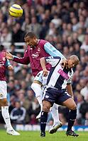 Photo: Daniel Hambury.<br />West Ham Utd v West Bromwich Albion. The Barclays Premiership. 05/11/2005.<br />West Ham's Danny Gabidon (L) gets above West Brom's Robert Earnshaw.