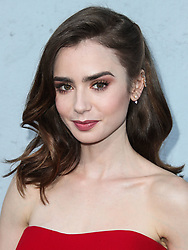 Lily Collins wearing a Reem Acra dress with Djula and Maxior jewelry arrives at the Los Angeles Premiere Of Amazon Studios' 'The Last Tycoon' held at the Harmony Gold Preview House and Theater on July 27, 2017 in Hollywood, California. 27 Jul 2017 Pictured: Lily Collins. Photo credit: IPA/MEGA TheMegaAgency.com +1 888 505 6342