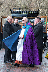 © Licensed to London News Pictures. 28/03/2018. Liverpool, UK. The horse drawn cortege , with a floral Diddy Man propped up against the coffin , arrives at Liverpool Cathedral for the funeral of comedian and performer Sir Ken Dodd , who died on 11th March 2018 at the age of 90 . Photo credit: Joel Goodman/LNP