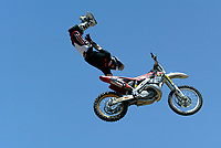 """Jul 01, 2003; Anaheim, California, USA; Moto X star athlete ROBERT DISTLER executing a tremendous stunt hands free flying in the air with a full sized motobike at the opening of Disney's California Adventure """"X Games Experience"""".  Disney park has built two X-Arena's specifically for this 41 day event highlighting extreme sports for the launch of the 2003 ESPN X Games.<br />Mandatory Credit: Photo by Shelly Castellano/Icon SMI<br />(©) Copyright 2003 by Shelly Castellano"""