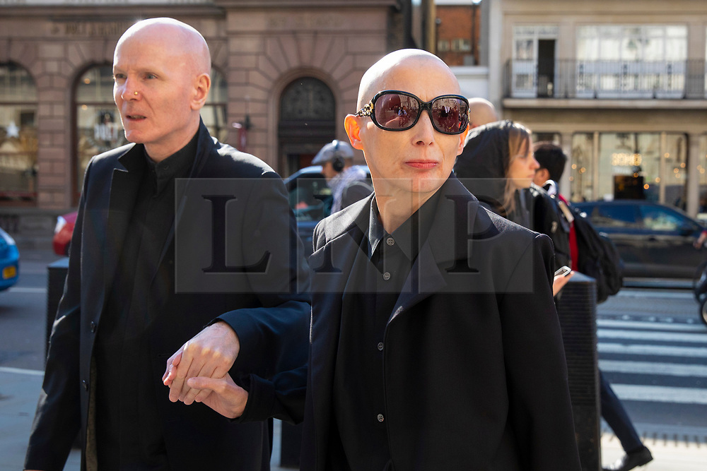 © Licensed to London News Pictures. 18/04/2018. London, UK. Campaigner Christie Elan-Cane (R) arrives at The Royal Courts of Justice for the start of a two-day hearing over gender neutral 'X' passports.  Elan-Cane believes the UK's passport application process, which requires individuals to indicate whether they are male or female, is discriminatory. Photo credit: Rob Pinney/LNP