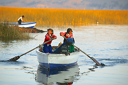 Boaters Near Floating Island