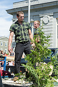 BAR HARBOR, MAINE, July 4, 2014. Lumberjacks on the Great Maine Lumberjack Show float in the Independence Day Parade