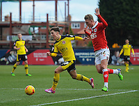 Fleetwood Town's Nick Haughton vies for possession with Bristol City's George Saville<br /> <br /> Photographer Ashley Crowden/CameraSport<br /> <br /> Football - The Football League Sky Bet League One - Bristol City v Fleetwood Town - Sunday 1st February 2015 - Ashton Gate - Bristol<br /> <br /> © CameraSport - 43 Linden Ave. Countesthorpe. Leicester. England. LE8 5PG - Tel: +44 (0) 116 277 4147 - admin@camerasport.com - www.camerasport.com