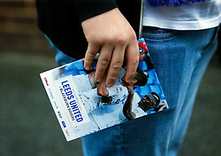 A man holds program ahead of the  Leeds United v  Blackburn Rovers  EFL Cup Third Round at  Elland Road Stadium in Leeds.