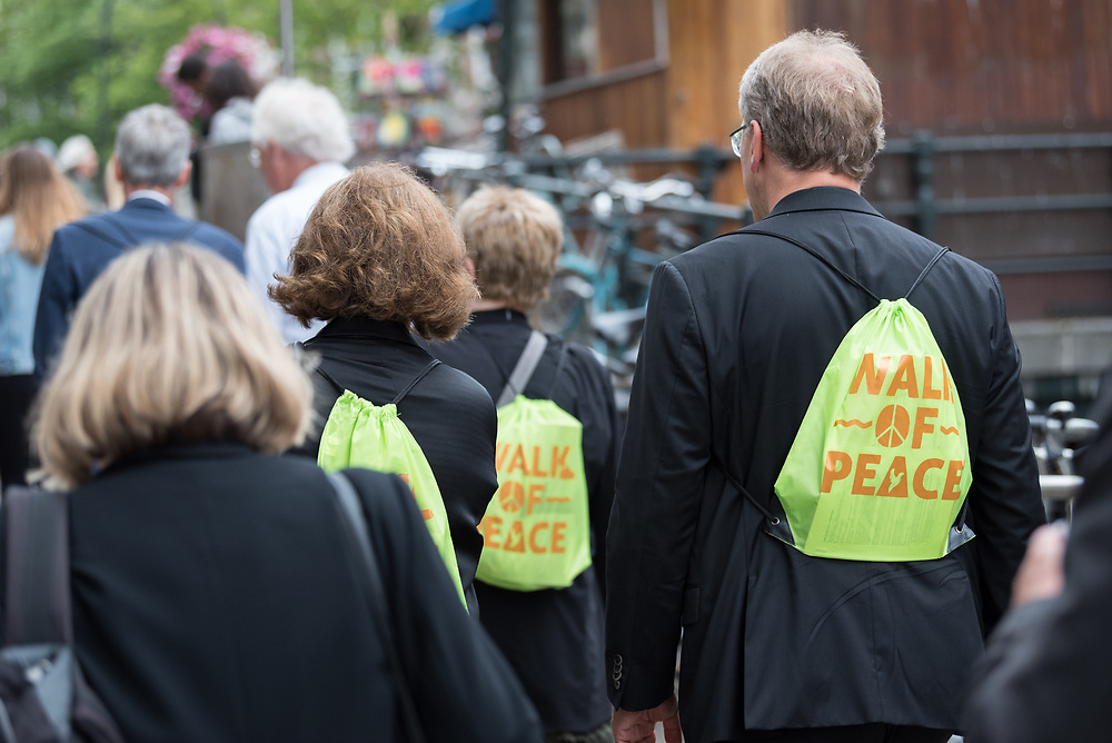 23 August 2018, Amsterdam, Netherlands: Rev. Dr Olav Fykse Tveit (right) and Berit Hagen Ag¯y (middle) participate in a Walk of Peace. A ìWalk of Peaceî on 23 August in Amsterdam gathers hundreds of young people and religious leaders who, as they stroll together, celebrating the ecumenical movement and challenging each other to accomplish even more. The walk offers moments of reflection and prayer at several houses and buildings - including a synagogue, the Santí Egidio Community, the Armenian Church, and many others - all of which carried stories of blessings, wounds and transformation.
