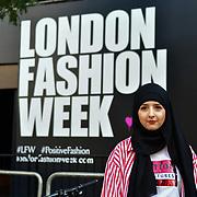 Sama Azizi @x.s13 wearing hijab modesty and beautiful attend London Fashion Week SS19 street photography at the Strand, London, UK. 17 September 2018.