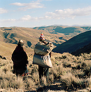 A Couple Walking across mountains north of Oruro, Bolivia