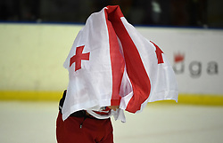 Cape Town 180420 Giorgia player covers himself with his national flag after their last game  in a Ice Hokey world championship against CHINA Taipei Grand West Casino.photograph:Phando Jikelo/African News Agency/ANA
