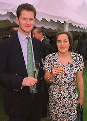 The HON.CAMILLA CECIL, she writes Jennifer's Diary for Harpers & Queen magazine and her fiance MR HENRY MOUNTAIN, at a polo match in Berkshire on 14th June 1998.MII 44