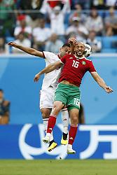 (l-r) Omid Ebrahimi of IR Iran, Nordin Amrabat of Morocco