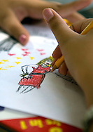 Hands of girl coloring.