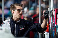 KELOWNA, BC - MARCH 6: Kelowna Rockets' equipment manager Chaydyn Johnson gets a new stick on the bench against the Seattle Thunderbirds at Prospera Place on March 6, 2020 in Kelowna, Canada. (Photo by Marissa Baecker/Shoot the Breeze)
