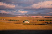 A newly built suburban home stands alone, set among fields in the predominantly agricultural Palouse Valley near Spokane, Washington.