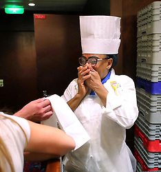Angela Dean, a pastry chef and the only Bahamian crew member on Royal Caribbean's Mariner of the Seas cruise ship cries as she sees for the first time the assembly line of crew members putting together 10,000 relief meals in the dining room of the ship, late Friday night, September 6, 2019, enroute to Freeport, Bahamas. Photo by Joe Burbank/Orlando Sentinel/TNS/ABACAPRESS.COM