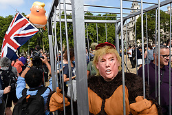"© Licensed to London News Pictures. 13/07/2018. LONDON, UK.  A man dressed as Donald Trump as a gorilla stands in a cage outside The Houses of Parliament.  At the same time, a giant ""Trump Baby"" balloon flies over Parliament Square in Westminster as part of a protest at President Donald Trump's visit to the UK.  Organisers have designed the 6m tall blimp, flying at a height of 30m,  depicting Donald Trump as a baby with small hands, holding a mobile phone and wearing a nappy.  Mass protests are also expected to take place in Central London in response to the visit of the President. Photo credit: Stephen Chung/LNP"