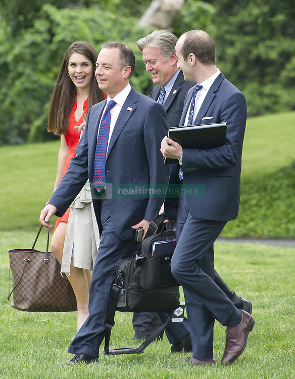 April 29, 2017 - Washington, District of Columbia, United States of America - From left to right: Hope Hicks, White House Director of Strategic Communications, Steve Bannon, Chief Strategist, White House Chief of Staff Reince Priebus, and White House Policy Advisor Stephen Miller walk across the South Lawn of the White House to join United States President Donald J. Trump aboard Marine One as he departs the White House in Washington, DC en route to Harrisburg, Pennsylvania where he will participate in a Make America Great Again Rally on Saturday, April 29, 2017..Credit: Ron Sachs / Pool via CNP (Credit Image: © Ron Sachs/CNP via ZUMA Wire)