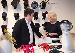 The Duchess of Cornwall chats with designer Paul Stafford during a visit to London Fashion Week at the BFC Show Space, London.