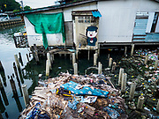 """22 MARCH 2018 - BANGKOK, THAILAND:  A demolished home along Khlong Lat Phrao. Bangkok officials are evicting about 1,000 families who have set up homes along Khlong  Lat Phrao in Bangkok, the city says they are """"encroaching"""" on the khlong. Although some of the families have been living along the khlong (Thai for """"canal"""") for generations, they don't have title to the property, and the city considers them squatters. The city says the residents are being evicted so the city can build new embankments to control flooding. Most of the residents have agreed to leave, but negotiations over compensation are continuing for residents who can't afford to move.     PHOTO BY JACK KURTZ"""