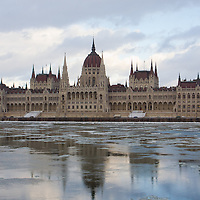 Building of the Hungarian Parliament is reflected on the surface of river Danube among ice blocks in the winter cityscape in Budapest, Hungary on February 15, 2012. ATTILA VOLGYI