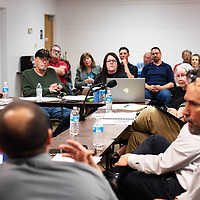 Library Advisory Board members, city staff and the public listen Monday evening at the Octavia Fellin Public Library as the architects from Huitt-Zollars talk about how they came up with the structural concept for the new library in Gallup.