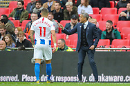 Brighton & Hove Albion manager Chris Hughton instructs Brighton & Hove Albion midfielder Anthony Knockaert (11) during the The FA Cup semi-final match between Manchester City and Brighton and Hove Albion at Wembley Stadium, London, England on 6 April 2019.