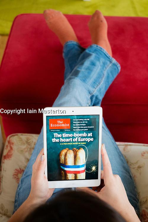 Reading digital edition of The Economist magazine on an iPad mini tablet computer