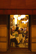 The main dining room at the restaurant full with dining guests and waiters serving seen from the outside The Oviedo Restaurant, Buenos Aires Argentina, South America