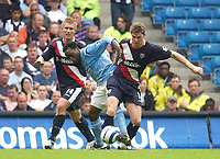 Photo: Daniel Hambury.<br /> Manchester City v West Bromich Albion. Barclaycard Premiership. 13/08/2005.<br /> Manchester City's  Kiki Musampa gets between West Brom's Martin Albrechtsen and Zoltan Gera.