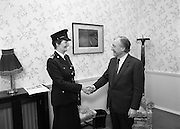 First Female Garda Superintendent.   (R97)..1989..21.02.1989..02.21.1989..21st February 1989..Ms Phyllis Nolan the first female Garda to reach the rank of Superintendent paid a courtesy call to An Taoiseach, Charles Haughey TD, at his office today. She was accompanied by the Garda Commissioner, Mr Eugene Crowley...Garda Superintendent Phyllis Nolan from Ballon, Co Carlow is pictured being congratulated on her appointment by An Taoiseach, Charles Haughey TD.She is the first female Garda to attain the rank of Superintendent.