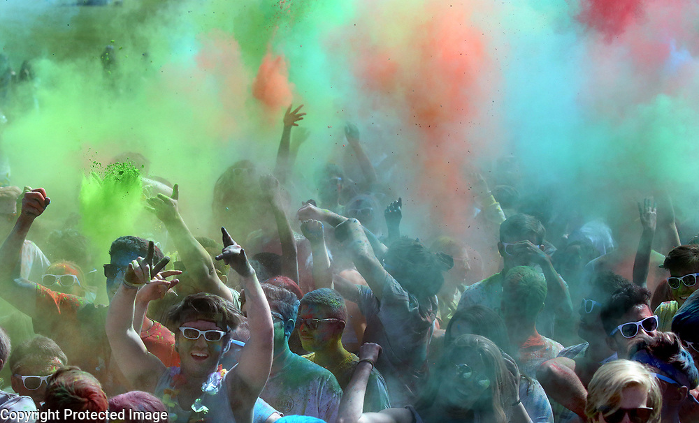 Colored powder files the air on the East Field at UC Santa Cruz as UCSC students celebrate the holiday of Holi. Holi, known as the Festival of Colors or the Festival of love, is an ancient Hindu religious festival and has become popular with non-Hindus groups around the world and has brought together different communities regardless of their religious and ethnic background. The Holi festival emphasizes a positive environment during the spring, where students celebrate love through colors. The festival has a significance of bringing people together through laughter, bridging the social gap between students on campus. The 5th annual UCSC Holi celebration was sponsored by the Student Union Assembly, the Indian Student Association, Tau Kappa Epsilon, and the Dean of Students<br /> Photo by Shmuel Thaler <br /> shmuel_thaler@yahoo.com www.shmuelthaler.com