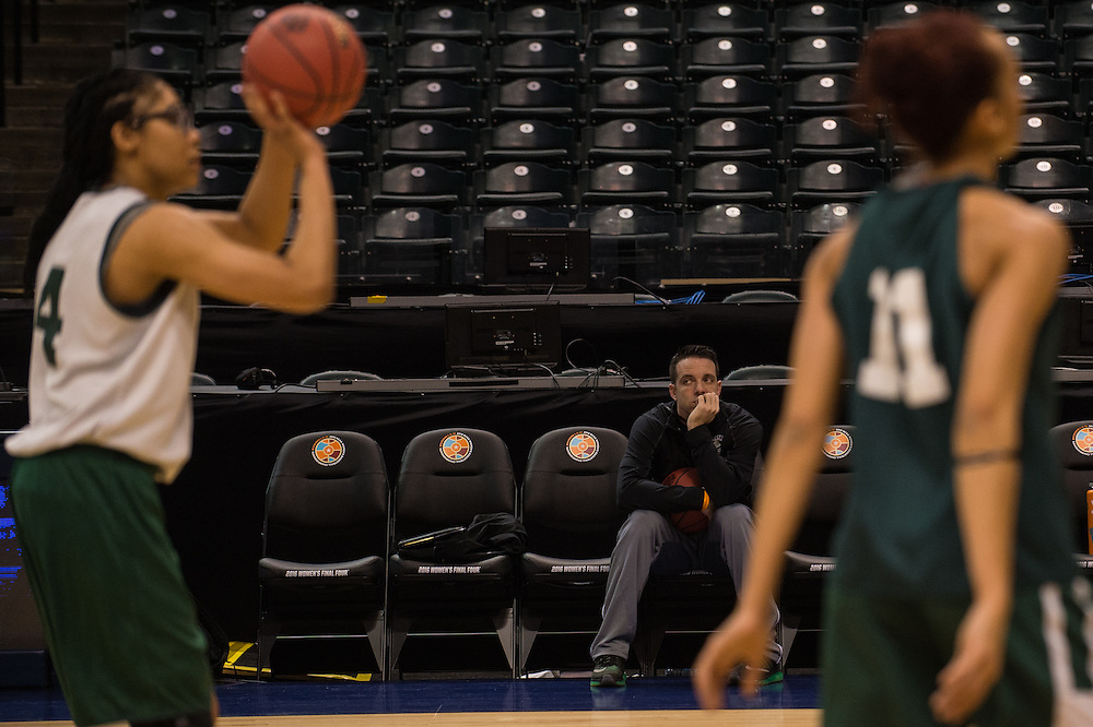 April 2, 2016; Indianapolis, Ind.; Head coach Ryan McCarthy watches Dominique Brooks take a shot during their practice session at Bankers Life Fieldhouse.