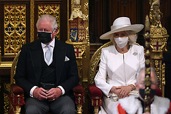 The Prince of Wales and the Duchess of Cornwall as Queen Elizabeth II delivers a speech from the throne in House of Lords at the Palace of Westminster in London as she outlines the government's legislative programme for the coming session during the State Opening of Parliament. Picture date: Tuesday May 11, 2021.