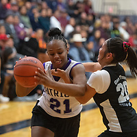 Nicole Money (21), left, with the ball as Noelle Charleston defends Wednesday night during the second annual Miyamura Alumni basketball game at Miyamura High School in Gallup.