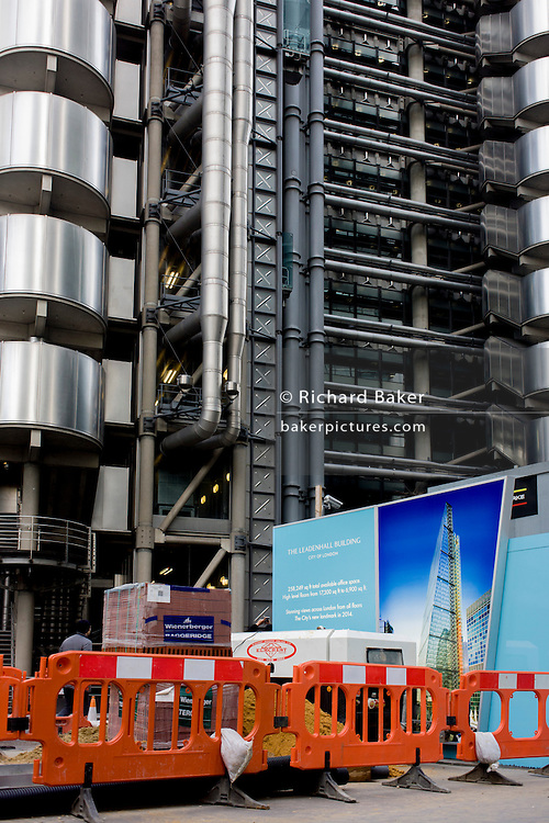 Lloyds of London and unfinished street construction near  Leadenhall Building by the Brookfield Multiplex construction company at 100 Bishopsgate.