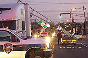 NEWSROOM, BURLINGTON CITY, 2/4/03.Burlington City Police, Fire and EMS responded to this motor vehicle accident at the corner of Rt 130 South and High Street in Burlington City Tuesday evening around 5:30 pm.  Officers say the Tractor Trailor was attempting to turn right on to North High Street from Rt 130 South when it knocked over the Traffic lights and the pole.  The Pole landed on top of the Trailor and on other vehicle causing minor damage to both.  No Injuries were reported.  (PHOTO BRYAN WOOLSTON)