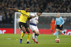BRITAIN-LONDON-FOOTBALL-UEFA CHAMPIONS LEAGUE-TOTTENHAM VS DORTMUND.(190213) -- LONDON, Feb.13, 2019  Tottenham Hotspur's Heung-Min Son (C) vies with Borussia Dortmund's Dan-Axel Zagadou (L) during the UEFA Champions League Round of 16 first Leg match between Tottenham Hotspur and Borussia Dortmund at Wembley Stadium in London, Britain on Feb. 13, 2019. Tottenham Hotspur won 3-0.  FOR EDITORIAL USE ONLY. NOT FOR SALE FOR MARKETING OR ADVERTISING CAMPAIGNS. NO USE WITH UNAUTHORIZED AUDIO, VIDEO, DATA, FIXTURE LISTS, CLUB/LEAGUE LOGOS OR ''LIVE'' SERVICES. ONLINE IN-MATCH USE LIMITED TO 45 IMAGES, NO VIDEO EMULATION. NO USE IN BETTING, GAMES OR SINGLE CLUB/LEAGUE/PLAYER PUBLICATIONS. (Credit Image: © Xinhua via ZUMA Wire)
