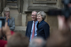 © Licensed to London News Pictures. 11/07/2016. London, UK. Home Secretary Theresa May stands outside Parliament with her husband Philip May . Mrs May will become Prime Minister on Wednesday after the Andrea Leadsom stood down earlier today. Photo credit: Peter Macdiarmid/LNP