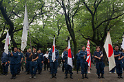 Members of the Uyoku-dantai (right-wing paraamilitary groups) parade with flags and banners as Yasukuni shrine marks the 72nd anniversary of the end of the Pacific War. Yasukuni Shrine, Kudanshita, Tokyo Japan. Tuesday August 15th 2017. Nominally a event to honour Japan's war dead and call for continued peace, this annual gathering  at Tokyo's controversial Yasukuni  Shine also allows many Japanese nationalists to display their nostalgia for their Imperial past.Rightwing paramilitary groups, Imperial cos-players, politicians and many ordinary citizens come together at the shrine to march and wave flags. The day goes almost unreported in the mainstream Japanese media.