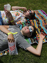 Popcorn and a total solar eclipse viewing make for an afternoon of entertainment for Meir Straus, 12, and his sister Isla, 9, who came all the way from Toronto for a solar eclipse shabbat at Ramah Darom on Monday, August 21, 2017, in Clayton, a city in the path of totality in North Georgia. Photo by Curtis Compton/Atlanta Journal-Constitution/TNS/ABACAPRESS.COM