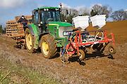 Farm machinery planting a crop of potatoes in a field, Shottisham, Suffolk, England