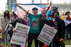 London, UK. 24th July, 2021. LGBTI+ protesters pose in front of Parliament before the first-ever Reclaim Pride march. Reclaim Pride replaced the traditional Pride in London march, which many feel has become too commercial and strayed from its roots in protest, and was billed as a People's Pride march for LGBTI+ liberation.