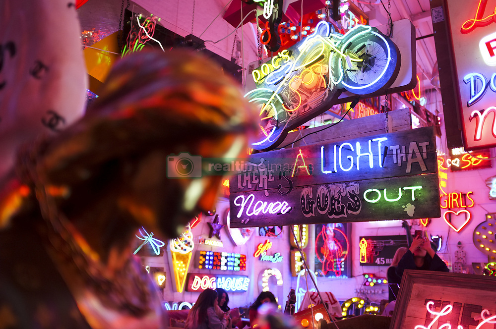 October 7, 2018 - London, United Kingdom - People visit God's Own Junkyard, the largest neon stock in Europe in east London on October 7, 2018. Gods Own Junkyard is a psychedelic paradise of neon lights and vintage signs, all hidden inside a warehouse in Walthamstow, East London  (Credit Image: © Alberto Pezzali/NurPhoto/ZUMA Press)