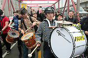 May 1, 2012- New York, United States- Occupy Bushwick & Occupy Williamsburg celebrate May Day with calls for General Strike-with No Work-No Housework-No shopping-No School march in the Williamsburg section of Brooklyn in the early morning and then march across the Williamsburg bridge where three persons were arrested for wearing masks, a violation of NYC penal code. Occupy Wall Street is a leaderless resistance movement with people of many colors, genders and political persuasions. Their belief holds that one thing we all have in common is that We Are The 99% that will no longer tolerate the greed and corruption of the 1%. We are using the revolutionary Arab Spring tactic to achieve our ends and encourage the use of nonviolence to maximize the safety of all participants. (Photo by Terrence Jennings).