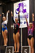 Young gymnastic athletes celebrate their wins on the podium; Region 4 Trampoline & Tumbling Meet; Duke Energy Center, Cincinnati, OH, USA.