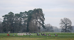 """Runners and riders race along the back straight in the """"The Smart Money's On Coral"""" Handicap Hurdle during the Coral Welsh Grand National day at Chepstow Racecourse."""