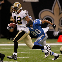 2009 September 13: New Orleans Saints safety Darren Sharper (42) returns and interception as Detroit Lions wide receiver Dennis Northcutt (86) pursues during a 45-27 win by the New Orleans Saints over the Detroit Lions at the Louisiana Superdome in New Orleans, Louisiana.