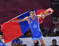 JAKARTA, Aug. 19, 2018  Bekhbayar Erdenebat of Mongolia celebrates after winning the gold medal of Men's Wrestling Freestyle 57 kg Final against  Kang Kum Song of the Democratic People's Republic of Korea in the 18th Asian Games in Jakarta, Indonesia, Aug. 19, 2018. Erdenebat won 8-2. (Credit Image: © Li He/Xinhua via ZUMA Wire)