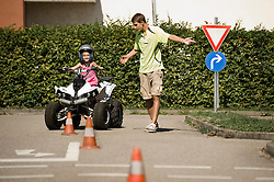 Tutor and girl with quadbike on driver training area