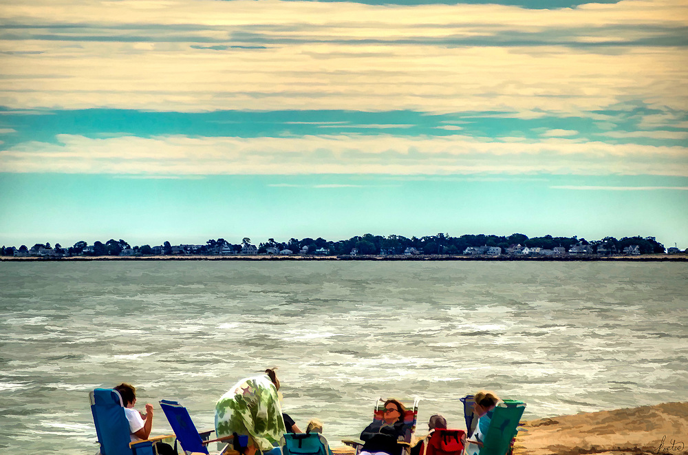 Five women enjoy a sunny but crisp outing at the beach in Southern Maine on an October day.